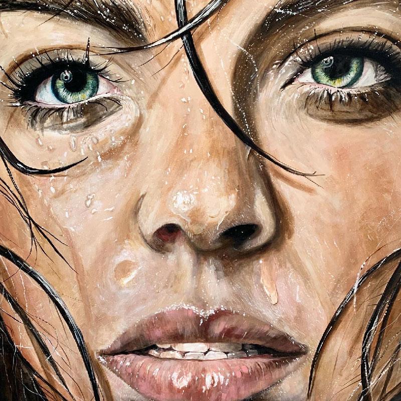 Das Bild zeigt ein Kunstwerk von der Künstlerin aus Aachen, Brigitte Schroeder. Das Bild zeigt ein Porträt einer wunderschönen Frau. Sie hat ein nasses Gesicht und Tropfen in den Haaren. Die Künstlerin legte viel Wert auf die detaillierte Darstellung.